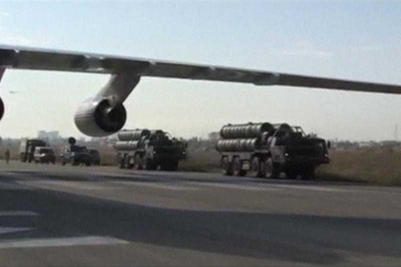 A frame grab taken from footage released by Russia's Defence Ministry November 26, 2015, shows Russian S-400 defense missile systems (R) driving on the tarmac of Hmeymim airbase in Syria. Russia sent an advanced missile system to Syria on November 25