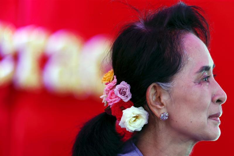 Aung San Suu Kyi speaks to the media,
