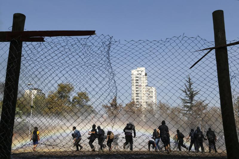 Student protesters clash with riot policemen (not pictured) during a demonstration to demand changes in the Chilean education system, in Santiago May 8, 2014.