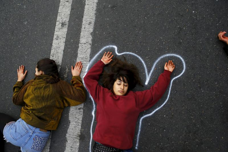 Demonstrators lie on the floor pretending to be dead, in reference to a student shot dead on May 14 after a protest march, during a rally, as Chile's President Michelle Bachelet delivers a speech inside the National Congress, May 21, 2015.