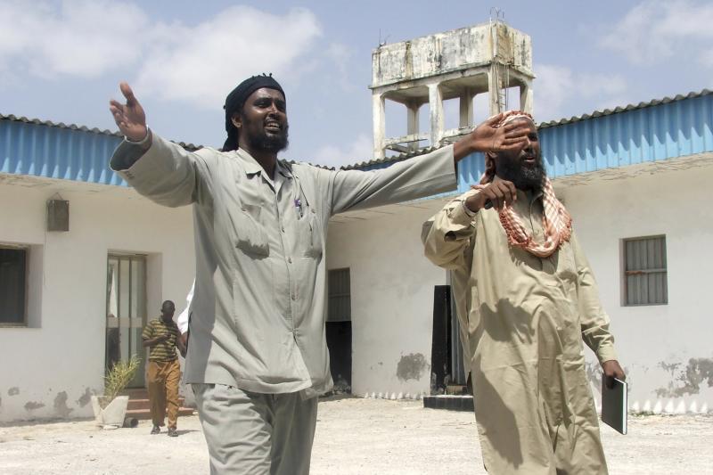 Deputy leader of the hardline Al-Shabaab Islamist group Sheikh Mokhtar Robow Abu Monsor (L) and spokesman of Al Shabab group Sheikh Ali Mohamud Rage (Ali Dhere) walk in Somalia's capital Mogadishu, January 4, 2010.