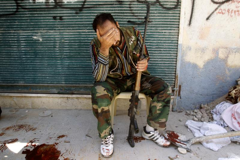 A Free Syrian Army fighter in Aleppo, August 2012. Syria is where Obama's foreign policy met its most brutal challenge.