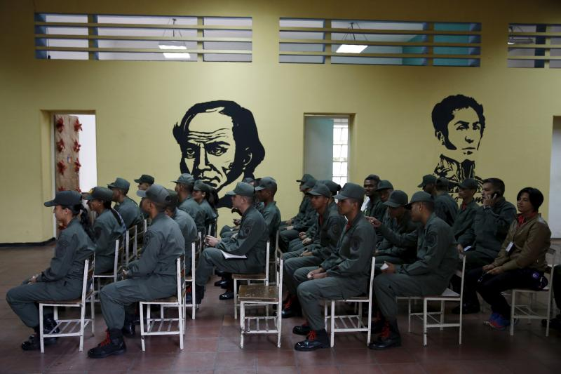 Soldiers sit at a polling station to cast their votes during a legislative election, in Caracas, December 6, 2015.