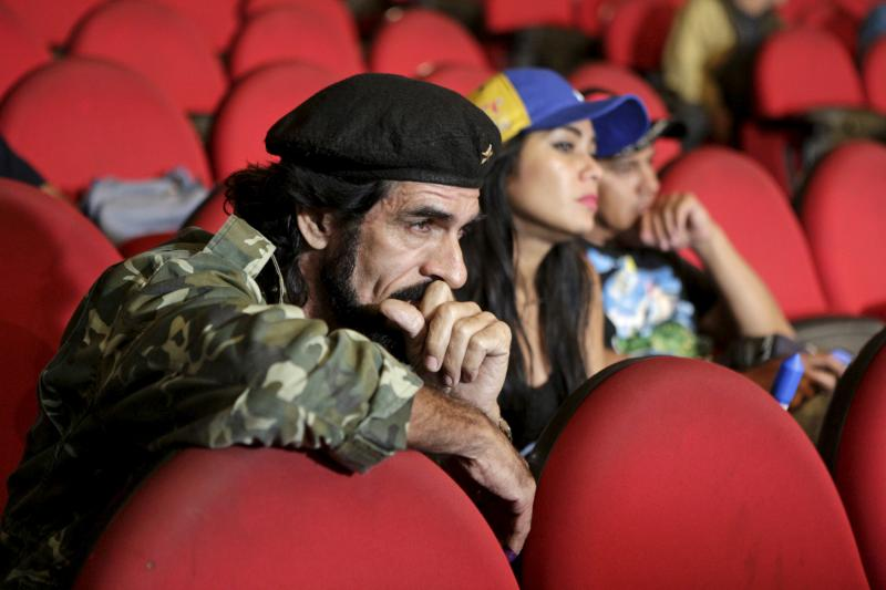 """Humberto Lopez, known as """"El Che,"""" reacts as National Electoral Council President Tibisay Lucena announces the official results of parliamentary elections in Caracas, December 7, 2015."""