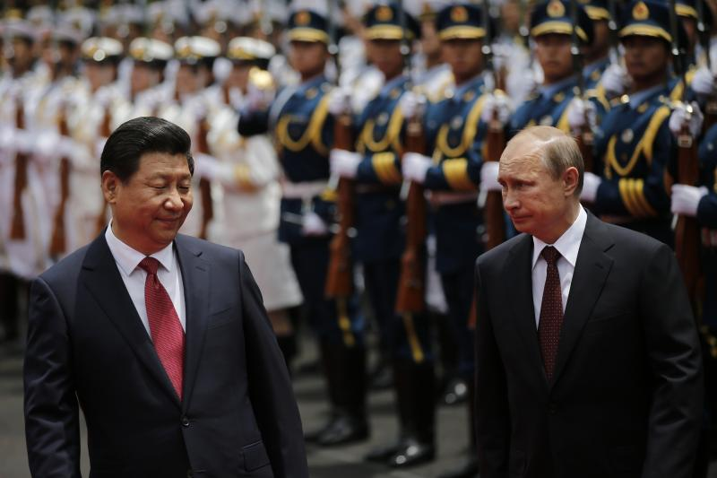 Russia's President Vladimir Putin and China's President Xi Jinping meet in Shanghai, May 2014.