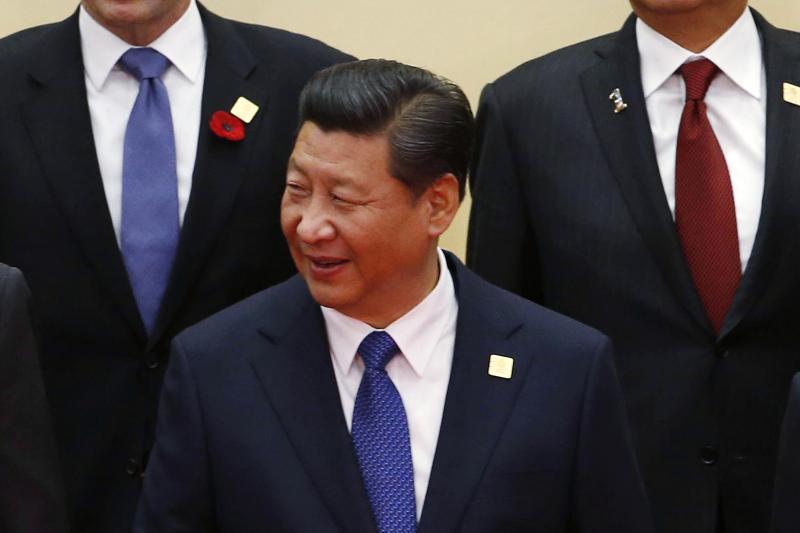 U.S. President Barack Obama, China's President Xi Jinping, and Russia's President Vladimir Putin in Beijing, November 2014.