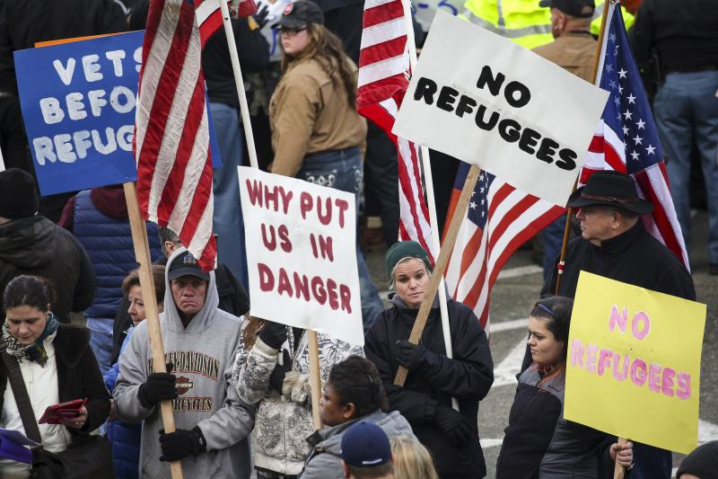 People gather to protest against the United States' acceptance of Syrian refugees in Olympia, Washington.