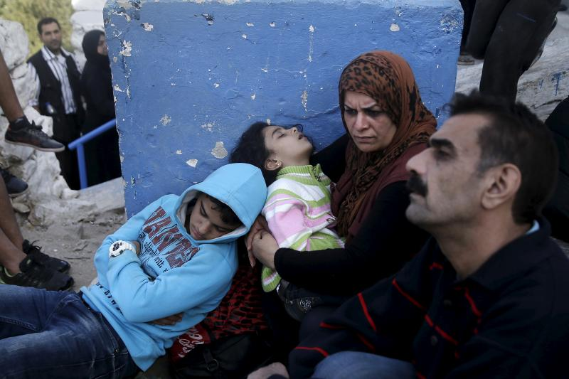 A family of Syrian refugees wait for a registration procedure in Agathonisi, Greece.