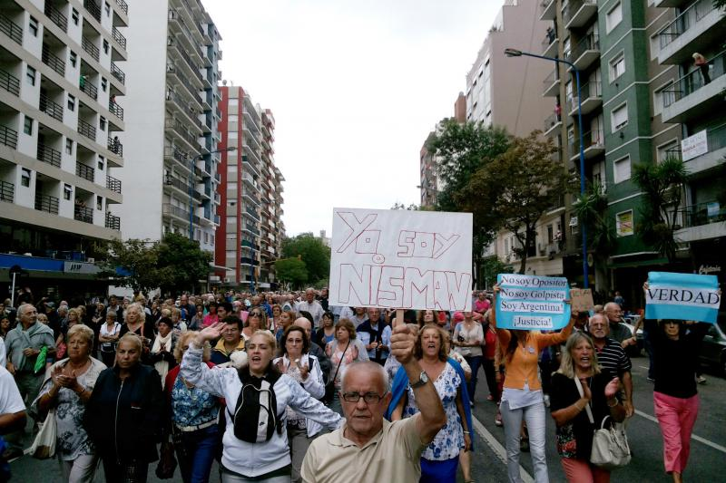 A march in honor of the late state prosecutor Alberto Nisman in Mar del Plata, Argentina, February 2015. Hundreds of thousands of Argentines joined demonstrations when Nisman died under mysterious circumstances.