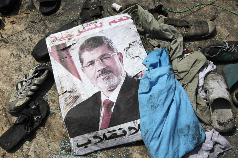A poster of deposed Egyptian President Mohamed Morsi amid the debris of a cleared protest camp in Cairo, August 2013. After mass protests, General Abdel Fattah el-Sisi seized power in a military coup.