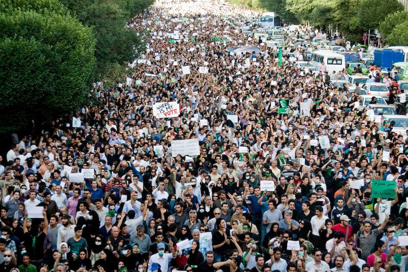 Supporters of the Iranian Green Movement march in protest at rigged elections in Tehran, 2009