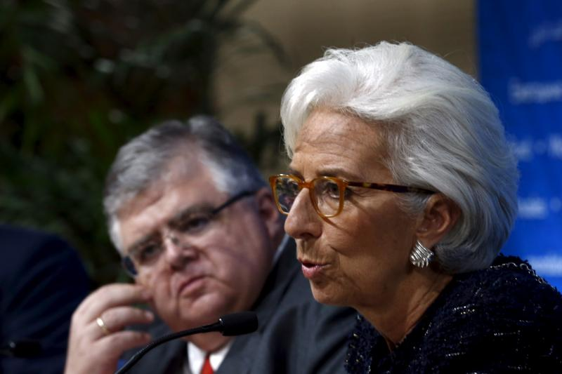 International Monetary Fund (IMF) Managing Director Christine Lagarde (R) talks at a news conference next to Mexico's central bank Governor Agustin Carstens, Lima, Peru, October 2015.