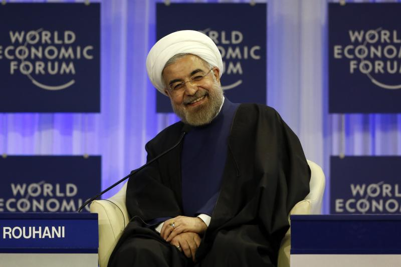 Iran's President Hassan Rouhani smiles at a panel in Davos