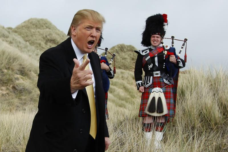 U.S. property mogul Donald Trump gestures during a media event on the sand dunes of the Menie estate, the site for Trump's proposed golf resort, near Aberdeen, north east Scotland, May 27, 2010.