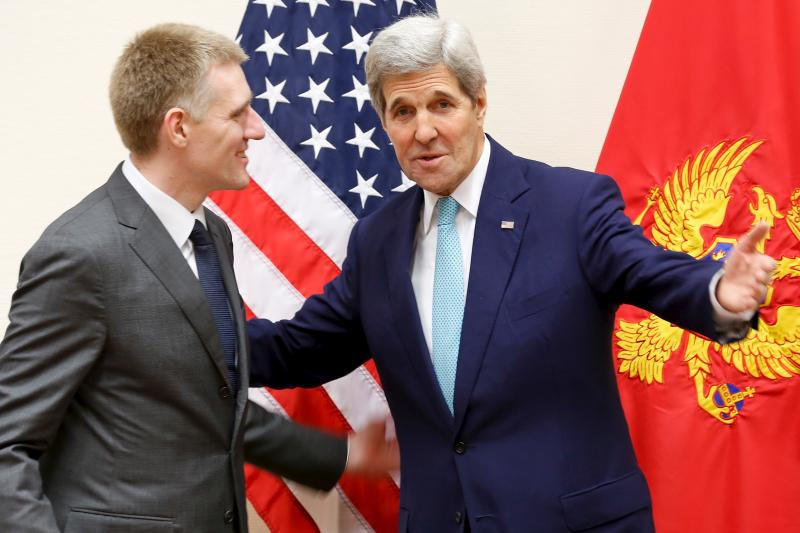 John Kerry meets Montenegro's Foreign Minister Igor Luksic at the NATO ministerial meetings at NATO Headquarters.