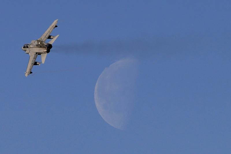 An RAF jet takes off, days after Parliament voted to authorize airstrikes against ISIS in Syria