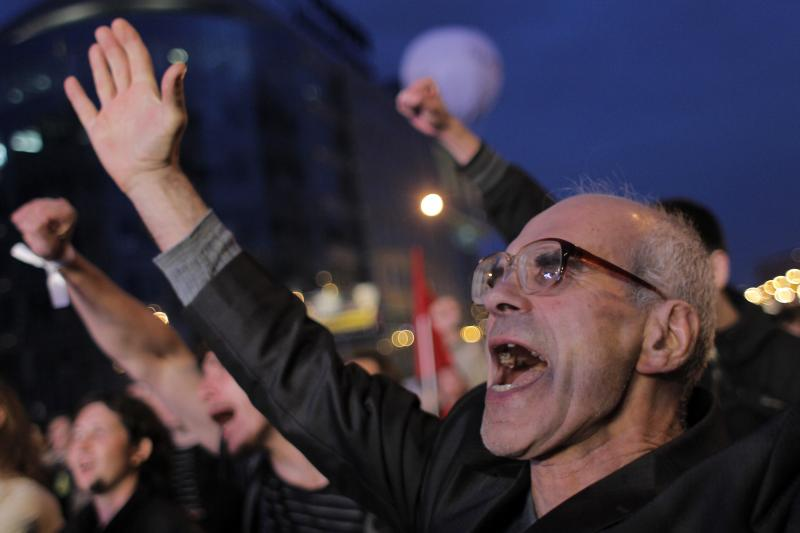 """People shout slogans during the """"March of Millions"""" protest rally in Moscow, September 15, 2012."""