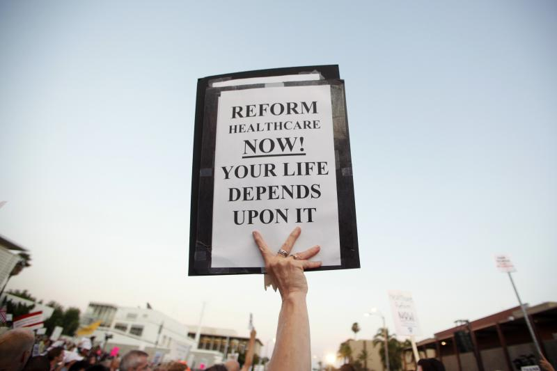 A sign in support of healthcare reform is held up at a town hall meeting on healthcare reform in Alhambra, California, August 11, 2009.