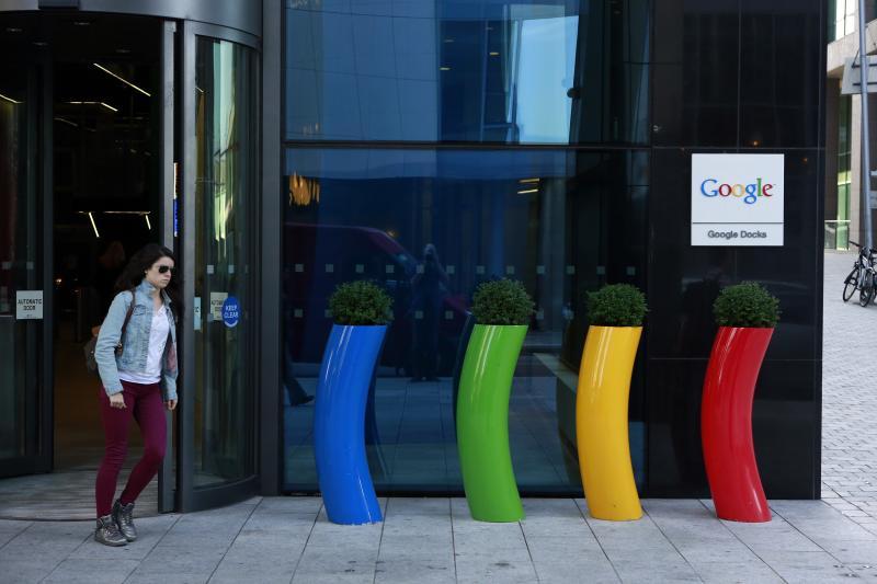 A woman walks past Google's European headquarters in Dublin