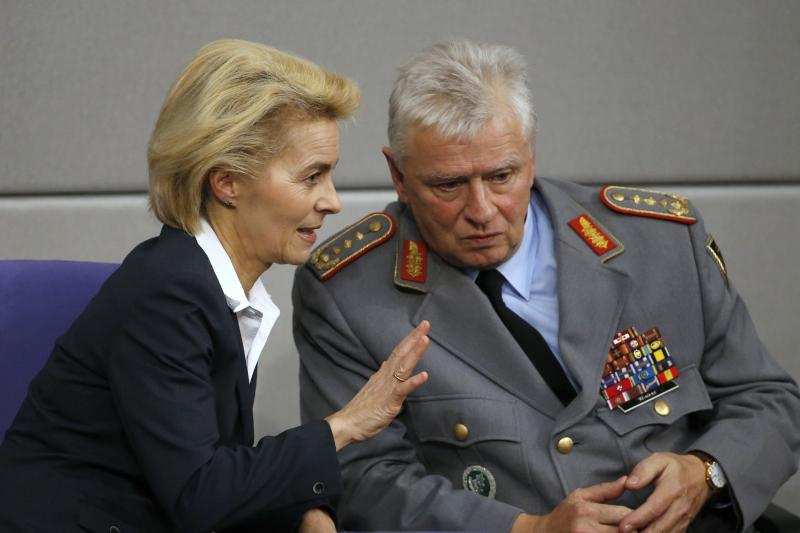 German Defense Minister Ursula Von der Leyen  with Chief of Staff of the German Armed Forces  Volker Wieker in Berlin, December 2015.  The United States has pressed its European NATO allies to increase military spending.