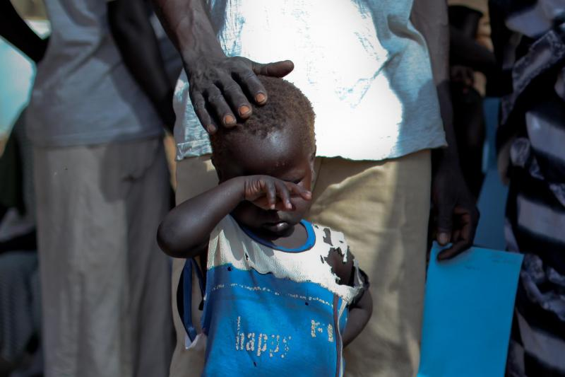 A boy who fled a war across the border in Sudan's Blue Nile state waits in a queue outside a clinic in Doro refugee camp, March 9, 2012.