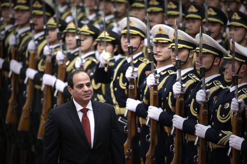 Egypt's President Abdel Fattah al-Sisi inspects honour guards with China's President Xi Jinping (not pictured) during a welcoming ceremony at the Great Hall of the People in Beijing, December 23, 2014.