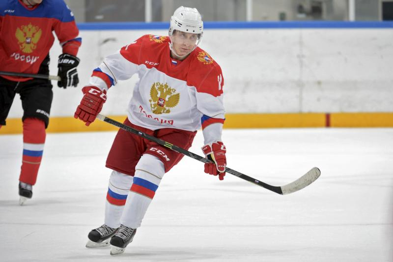 Russian President Vladimir Putin skates during a training session of participants of the Night Ice Hockey League in Krasnaya Polyana, Sochi, Russia, January 6, 2016.