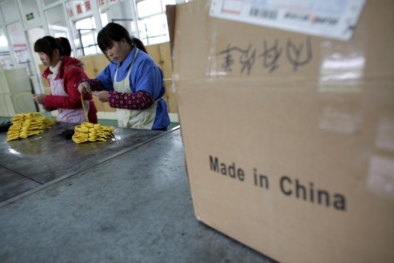 Laborers return to work in a factory in Shanghai, after Chinese New Year, 2012