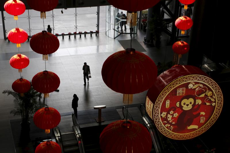 Large traditional lanterns and a sign of celebrating the upcoming new year of the Monkey are installed at a commercial building in Beijing, China, January 26, 2016.