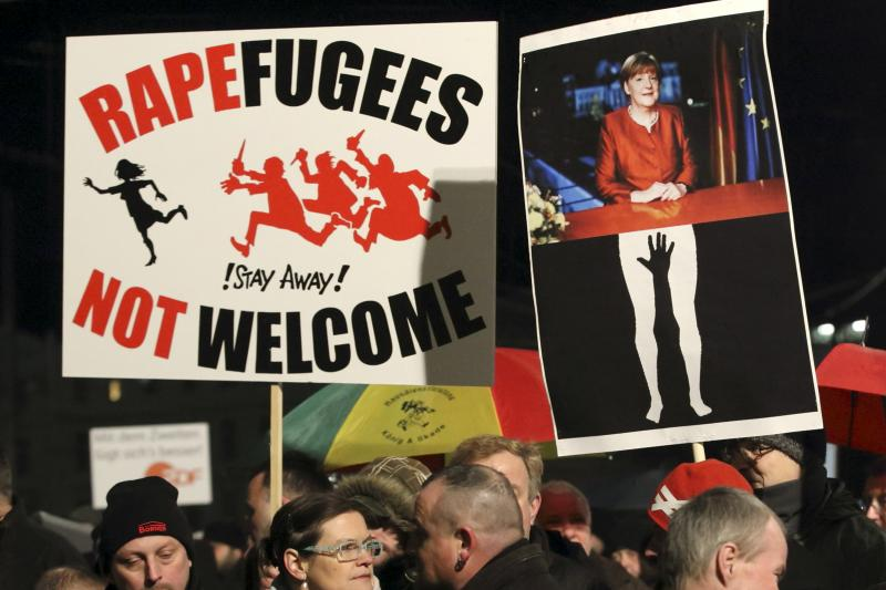 Members of LEGIDA, the Leipzig arm of the anti-Islam movement Patriotic Europeans Against the Islamisation of the West, take part in a rally in Leipzig, Germany