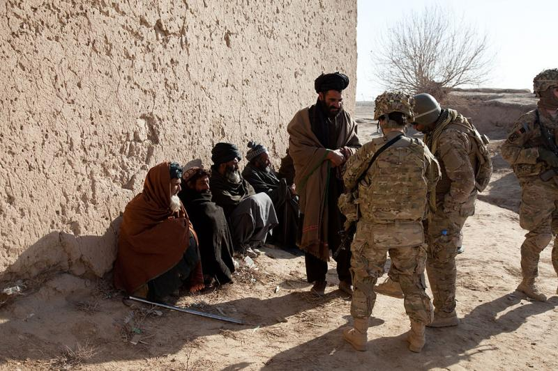 U.S. Army Romy Marroquin, right, with Human Terrain Team, 3rd Brigade Support Team Battalion, 3rd Brigade Combat Team, 10th Mountain Division, talks with village residents, during a dismounted patrol in Sher'Ali Kariz, Maiwand district, Kandahar province,