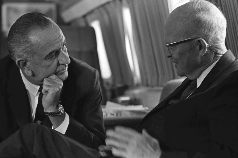U.S. President Lyndon B. Johnson meets with former U.S. President Dwight D. Eisenhower abroad Air Force One, Andrews Air Force Base, Maryland, October 5, 1965.