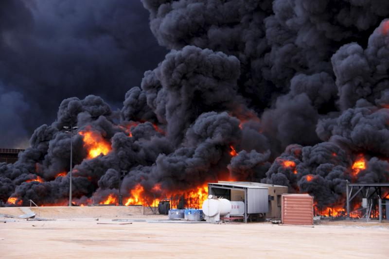 Smoke from an oil fire in Es Sider, in Ras Lanuf, Libya, January 6, 2016. Firefighters have extinguished two fires at oil storage tanks at Libya's Ras Lanuf terminal, but blazes continue at five tanks in the nearby port of Es Sider after attacks this week