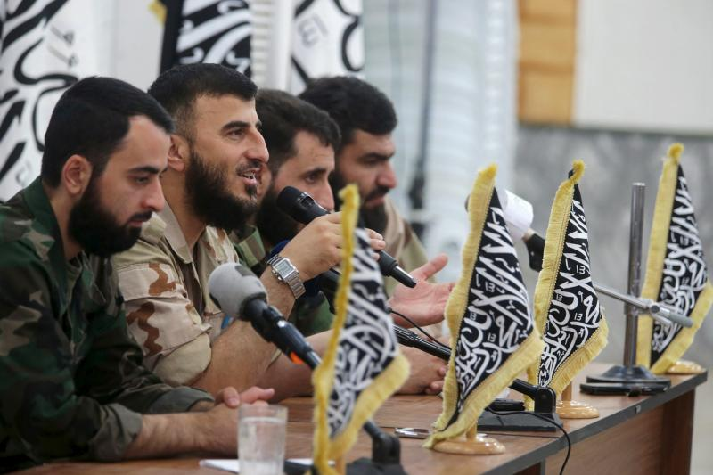 Zahran Alloush (2nd L), commander of Jaysh al Islam, talks during a conference in the town of Douma, eastern Ghouta in Damascus, Syria August 27, 2014.