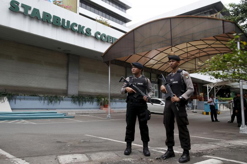 Indonesian police stand guard in central Jakarta, Indonesia, January 2016.