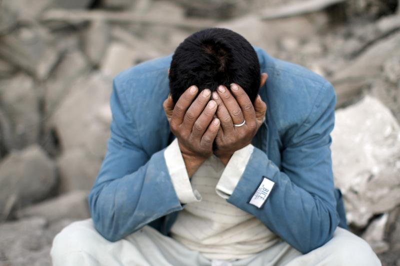 A man mourns for relatives killed by an air strike in Sanaa, Yemen, September 2015. Stepping back from the Middle East means risking the near-term collapse of Egypt, Jordan, Lebanon, Tunisia, and Turkey.