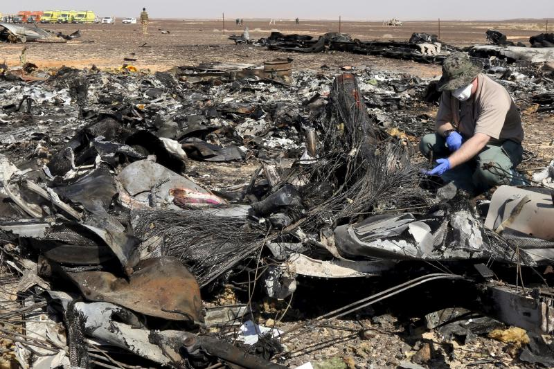 A Russian military investigator stands near the debris of a Russian airliner at its crash site in north Egypt, November 2015.