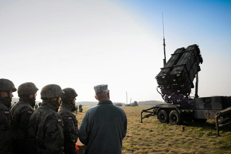 Polish and U.S soldiers look at a Patriot missile defense battery during join exercises at the military grounds in Sochaczew, near Warsaw, March 21, 2015.