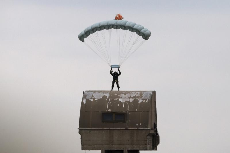 A Russian paratrooper descends to the ground during a training exercise in the village of Nikinci, west from Belgrade, November 14, 2014.