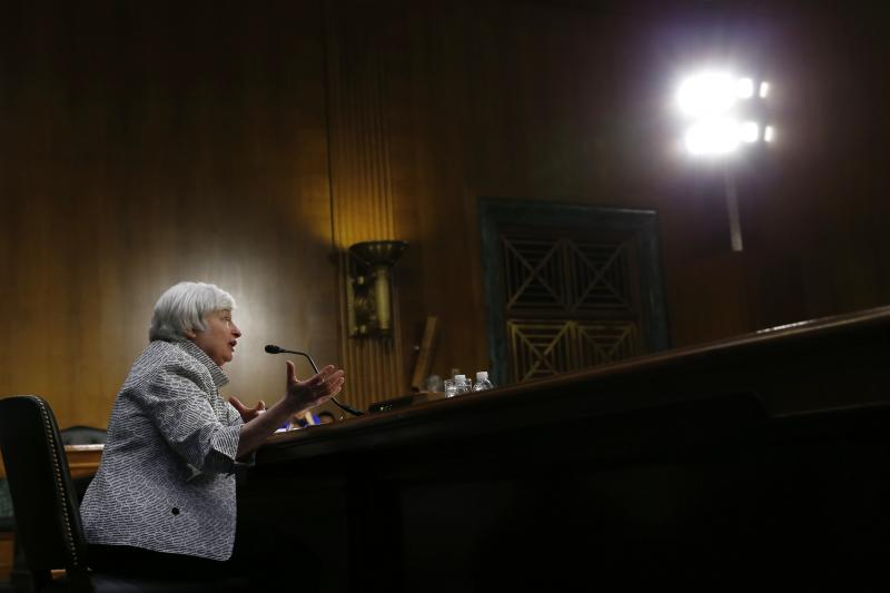 U.S. Federal Reserve Chair Janet Yellen testifies before the Senate Banking Committee in Washington, July 2014. Even with the Fed's aggressive monetary policies, the recovery has fallen significantly short of predictions.