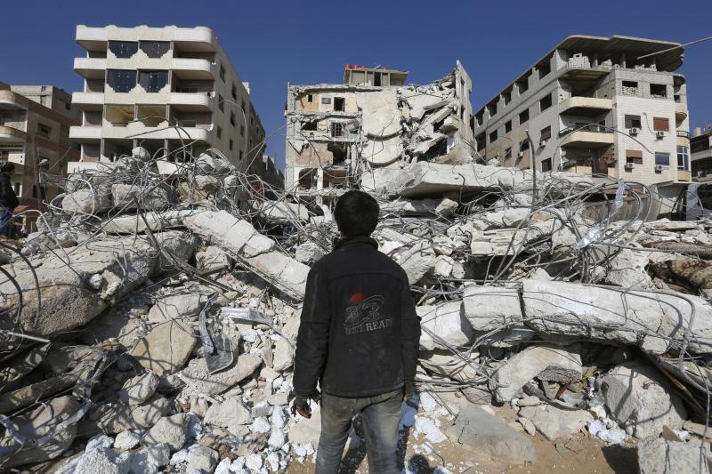 A civilian inspects a site that hit by an Israeli strike in Damascus, December 2015. If the next U.S. president is unwilling to commit to stepping up to stabilize the Middle East, the only real alternative is to step back.