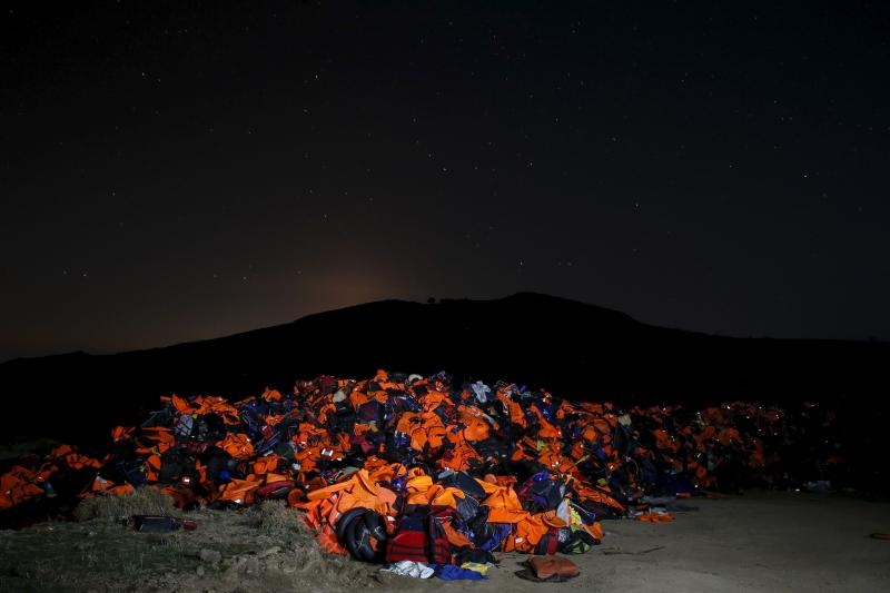 A long exposure photo shows thousands of lifejackets left by migrants and refugees, piled up at a garbage dump site on the Greek island of Lesbos, November 9, 2015.