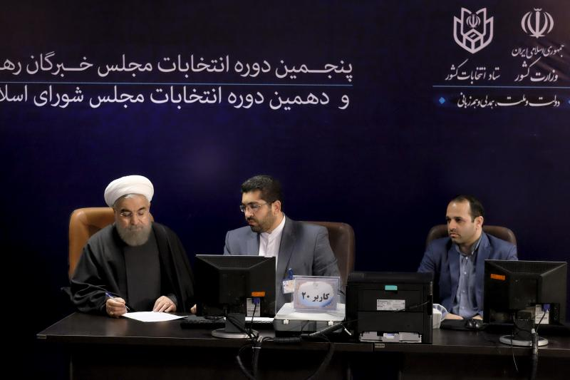 Iranian President Hassan Rouhani (L) registers for February's election of the Assembly of Experts, the clerical body that chooses the supreme leader, in Tehran December 2015.
