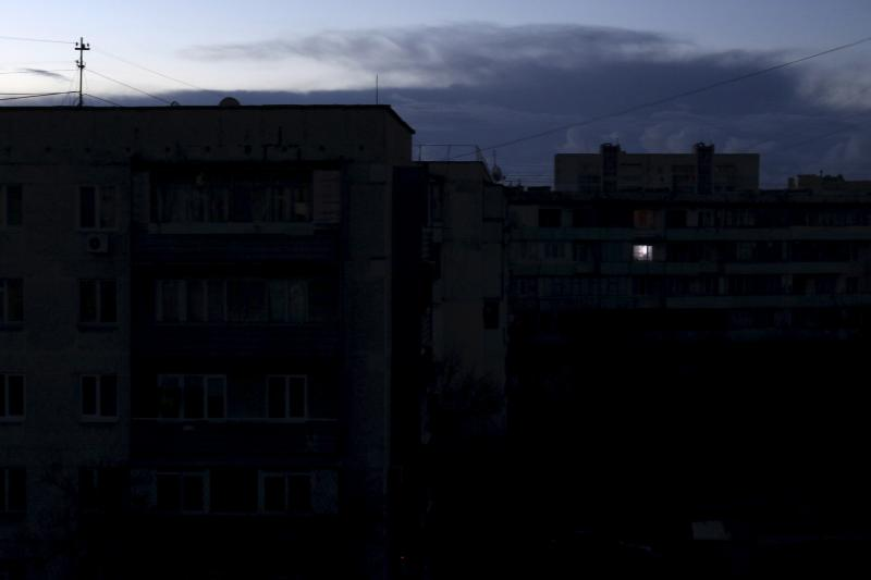 A single light illuminates a room during a blackout at a residential building in Yevpatoriya, Crimea, December 2, 2015. Ukraine's government has asked Tatar activists to allow repairs to the Kakhova-Tital electricity line to Crimea, but will only start re