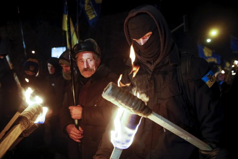 Activists of the Svoboda (Freedom), Ukrainian nationalist party, hold torches before a march to honor students killed during a military conflict in 1918 in Kiev. January 29, 2016.
