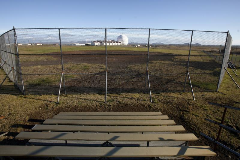 An abandoned baseball field and radar dome are left behind after the U.S. military ended its military presence in Iceland at the Keflavik Naval Air Station near Reykjavit September 30, 2006.