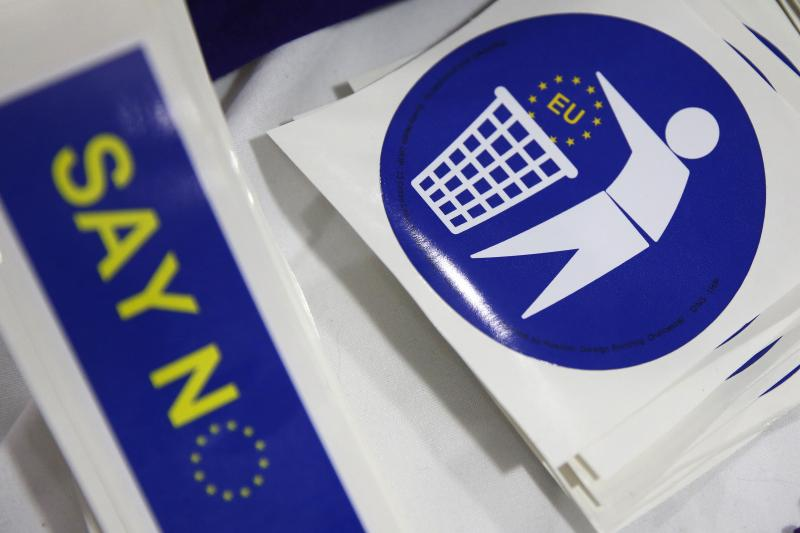 Badges with logos encouraging people to leave the EU are seen for sale on a stall at the UKIP party's spring conference, in Llandudno, Britain February 27, 2016.