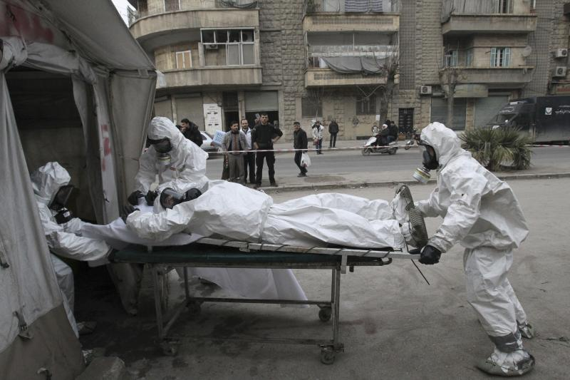 A Free Syrian Army medical group trains people on how to cope with chemical weapon attacks in Aleppo, December 25, 2013.