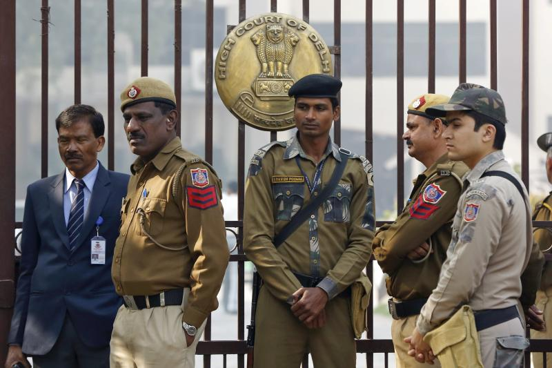 Policemen stand guard outside the high court during the bail hearing of Kanhaiya Kumar, a Jawaharlal Nehru University student union leader who was arrested for sedition, in New Delhi, India, February 2016.