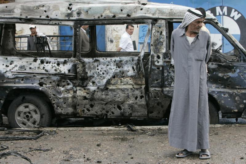 A man stands at the scene of a car bomb attack in Baghdad, April 2, 2007.